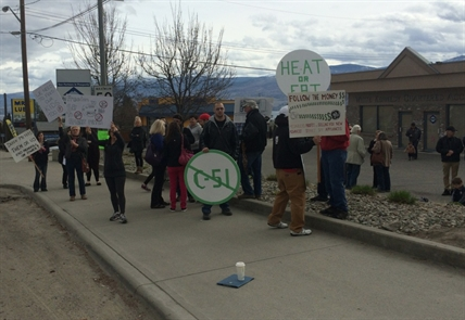 A small group of concerned citizens protested high power rates outside Premier Christy Clark's riding office in West Kelowna, Saturday, March 14, 2015.