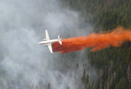 Retardant is dropped on a fire in 2009. Two of these aircraft worked the Kamloops Lake fire on Saturday, laying a retardant guard.