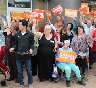Eager NDP fans wave to NDP leader Adrian Dix as he walked towards the party's Penticton campaign office Monday evening.
