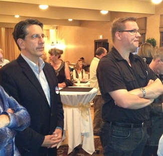 8:50 pm Lib candidate Dan Ashton and supporter Andrew Jakubeit watch early results at Ramada Inn.