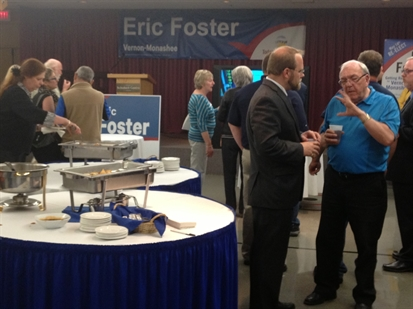 A crowd starts to build at the Liberal campaign party for Eric Foster.