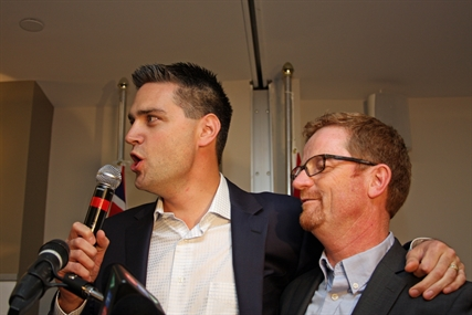 Liberal candidates Todd Stone and Terry Lake of the Kamloops South and North Thompson ridings let out a cheer as they celebrate with a crowded room at Hotel 540 Tuesday night.