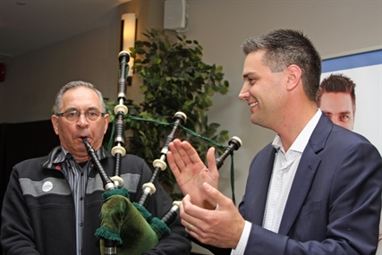 Conservative Peter Sharp plays the bagpipes for Liberal Todd Stone as he comes to congratulate him on his win.