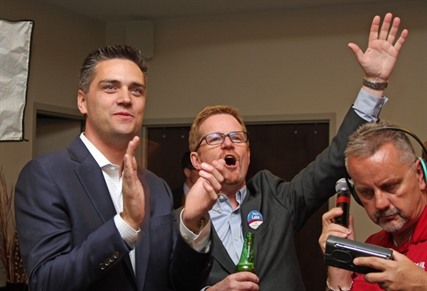 Kamloops Liberal candidates Todd Stone and Terry Lake celebrate as another Liberal candidate takes a seat elsewhere in the province.