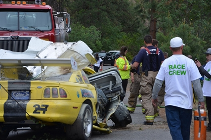 Two fire trucks were on scene at the Knox Mountain accident to put out the smoke smoldering from the Ford Mustang GTO.