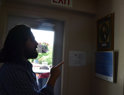 Walraven points to a photo of Frederic Ozanam the founder of the Society of St. Vincent De Paul that runs Ozanam House. The society procures funding and donations for the house, with the remaining funds provided through the resident's income assistance.