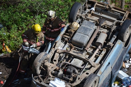 Rescue crews had to saw open the overturned vehicle in order to remove the deceased driver.