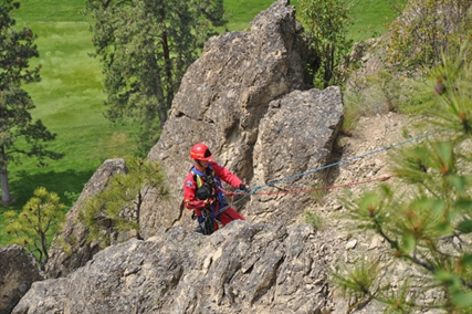 A firefighter had to repel down about 50 feet down a cliff to rescue the dog.