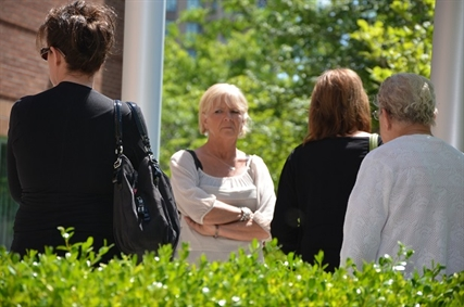 Family members of victim Lynn Kalmring gathered outside the Kelowna Supreme Court today, following an unexpected adjournment of the jury trial.