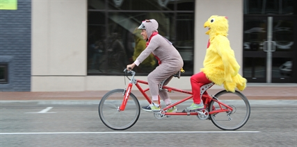 Penticton acting mayor Garry Litke and city manager Annette Antoniak dressed up as a chicken and deer to ride in front of city hall on Wednesday. This was the price for losing a bet with the Regional District Okanagan Similkameen in a Bike to Work Week contest.