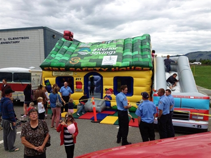 The new inflatable fire safety house helps local fire fighters teach fire safety to students.