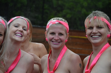 Patti Hillman and her friends braved the cold rainy weather today to zipline naked and raise money for breast cancer research