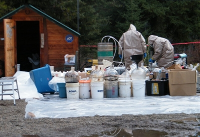 RCMP investigators on the scene of a super lab take down.