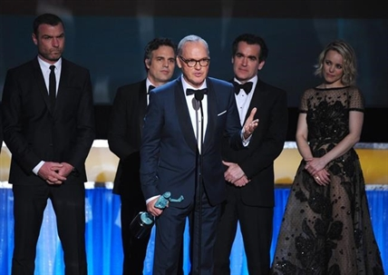 "Michael Keaton, foreground, accepts the award for outstanding cast in a motion picture for ""Spotlight"" as fellow cast members, background from left, Liev Schreiber, Mark Ruffalo, Brian d'Arcy James, and Rachel McAdams look on, at the 22nd annual Screen Actors Guild Awards at the Shrine Auditorium & Expo Hall on Saturday, Jan. 30, 2016, in Los Angeles."