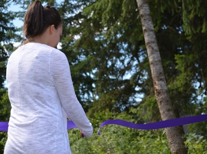Taylor's twin sister Kirstie cuts the ribbon, officially opening the trail.