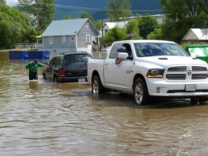 Flooding in the back parking lot of the Sheardowns grocery store in Lumby on June 21.