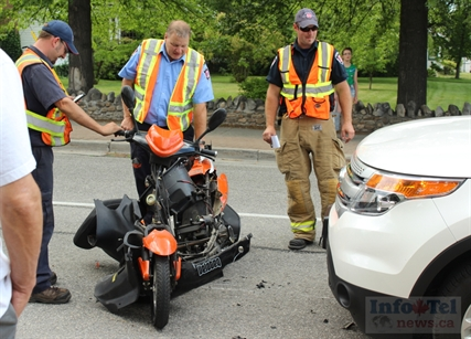 Emergency responders attend a collision between a moped and a white truck late Wednesday afternoon in front of Eckhardt Dental Centre on Martin Street. The truck's driver was instructed to drive her vehicle off the moped. There was no sign of the moped's rider.