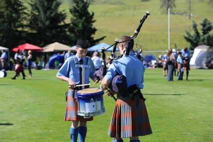 A drummer and a piper compete at the Kamloops Highland Games.