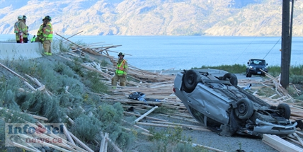 The driver and passenger of this car were taken to Penticton Regional Hospital with minor injuries. The flipped car was at the same site where a transport truck carrying lumber flipped and crashed late Monday afternoon on Highway 97. The crash site was several kilometres north of Summerland and northbound traffic was delayed for 30-minutes plus.