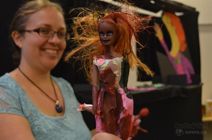 Stephanie Vollick holds a zombified Barbie, inspired by the hit T.V. show The Walking Dead and science fiction novels.