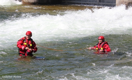 Two Penticton firefighters practice swiftwater rescue training on Thursday at the mouth of the Okanagan River channel.