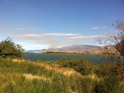 The smoke from the Kamloops Lake brush fire burning north of lake across from the Tobiano Golf Course.