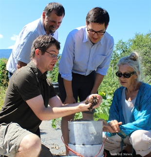 Waste official Cameron Baughen of the Regional District of Okanagan and Similkameen holds some worms up on Saturday for district chair person Mark Pendergraft, Penticton councillor Wesley Hopkin and Penticton Community Garden President Carol Allen.