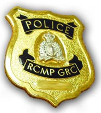 Cpl. Dan Moskalyk advises residents to ask for a police badge, shown here, to confirm whether someone who pulls you over is a real police officer.
