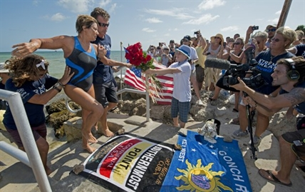 Endurance swimmer Diana Nyad is helped to shore and welcomed by her team after swimming a short distance from a support boat August 21, 2012 in Key West, Florida. Nyad failed in a fourth attempt to complete a swim across the Florida Straits from Cuba to the Florida Keys.