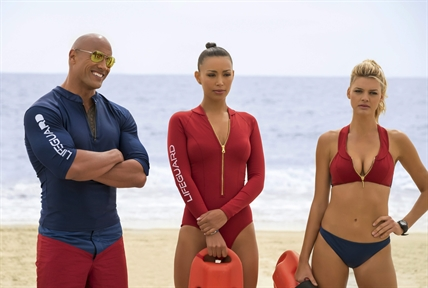 "This image released by Paramount Pictures shows Dwayne Johnson as Mitch Buchannon, from left, Ilfenesh Hadera as Stephanie Holden and Kelly Rohrbach as CJ Parker in ""Baywatch."""
