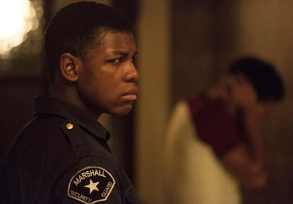 "This image released by Annapurna Pictures shows John Boyega in a scene from ""Detroit."""