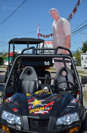 George hangs out atop an ATV at a local Enderby business.
