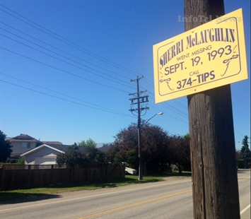 A sign asking for tips remains where Sherri McLaughlin's bicycle was found 20 years ago.