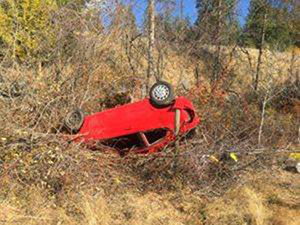 A vehicle rollover on Anarchist Mountain.