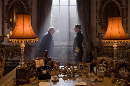 "This image released by Focus Features shows Gary Oldman as Winston Churchill, left, and Ben Mendelsohn as King George VI in a scene from ""Darkest Hour."""