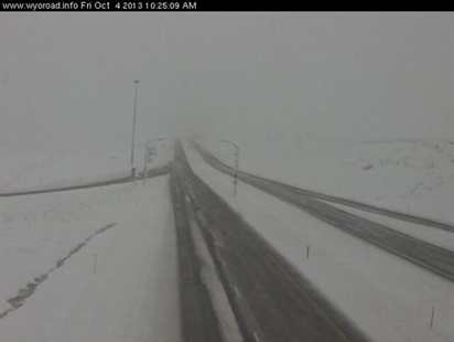 Traffic cam image from I-90 in Wyoming. Midwest storms bring heavy snow to the midwest.