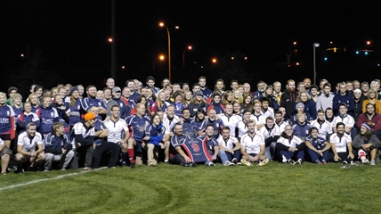 Kelowna Crows, young and old, gather at Parkinson Rec Centre for a group photo with Judah Campbell's rugby jersey on Oct. 10, 2013.