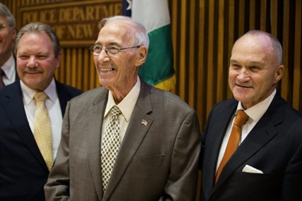 Former NYPD detective Jerry Giorgio smiles alongside Commissioner Ray Kelly, right.
