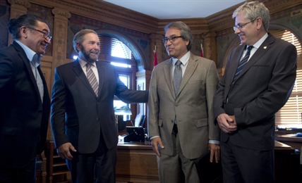 NDP MPs Charlie Angus (right), Romeo Saganash (left) and Official Opposition Leader Tom Mulcair meet with Special UN Rapporteur James Anaya to discuss his findings about issues facing First Nations in Canada, Tuesday October 8, 2013 on Parliament Hill in Ottawa.