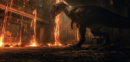 "This image released by Universal Pictures shows Bryce Dallas Howard, left, and Justice Smith in a scene from the upcoming ""Jurassic World: Fallen Kingdom."""