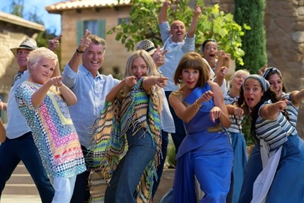 "This image released by Universal Pictures shows, foreground from left, Julie Walters, Pierce Brosnan, Amana Seyfried and Christine Baranski in a scene from ""Mamma Mia! Here We Go Again."""