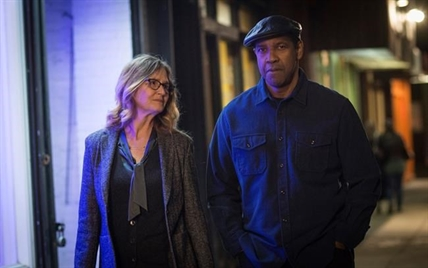"This image released by Columbia Pictures shows Melissa Leo, left, and Denzel Washington in a scene from ""Equalizer 2."""