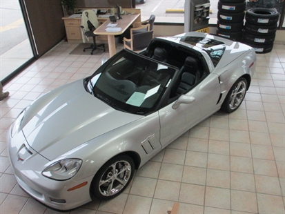 Thieves drove this 2011 Corvette through the glass wall of a Penticton car dealer Thursday night.The suspects are still at large.