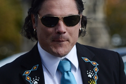 Senator Patrick Brazeau arrives at the Senate on Parliament Hill in Ottawa on Tuesday, Oct. 22, 2013.