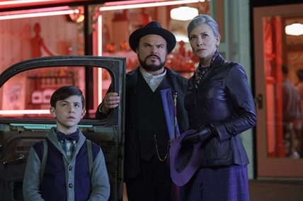 "This image released by Universal Pictures shows Owen Vaccaro, from left, Jack Black and Cate Blanchett in a scene from ""The House With A Clock in Its Walls."""