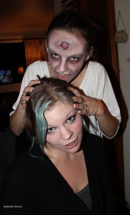 A zombified-Tori Giesbrecht poses with her friend and creator Penticton make-up artist Sheila Killins, 21.