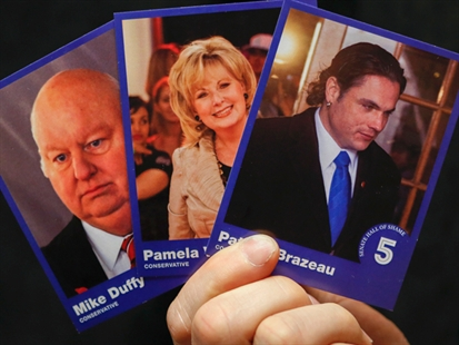 Mike Duffy, Pamela Wallin and Patrick Brazeau are among the senators featured on trading cards handed out by the federal NDP.