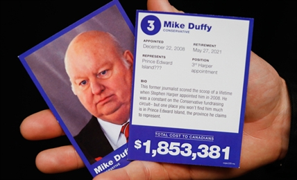 'Represents: Prince Edward Island???' A Mike Duffy trading card.