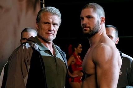 "This image released by Metro Goldwyn Mayer Pictures / Warner Bros. Pictures shows Dolph Lundgren, left, and Florian Munteanu in a scene from ""Creed II."""