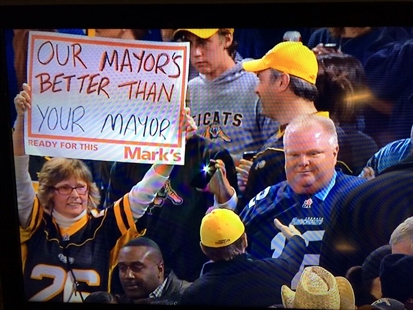A Hamilton Tiger Cats fan openly mocks Toronto mayor Rob Ford with her sign at the CFL eastern semifinal in Toronto on Sunday, Nov. 17, 2013.